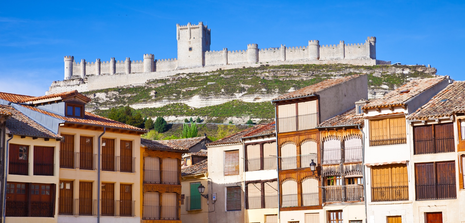 Medieval houses in Peñafiel, with the castle as background