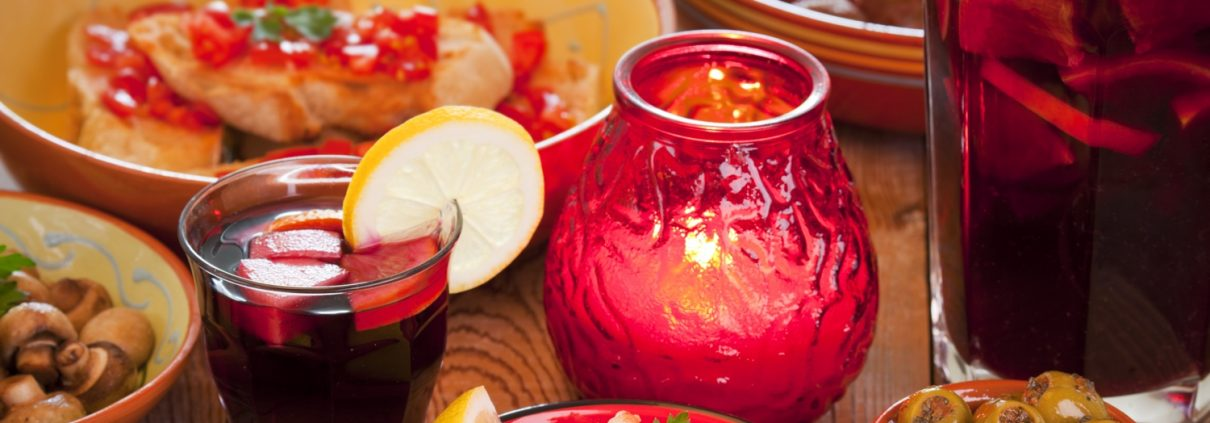 Assortment of Spanish tapas and sangria on a rustic table