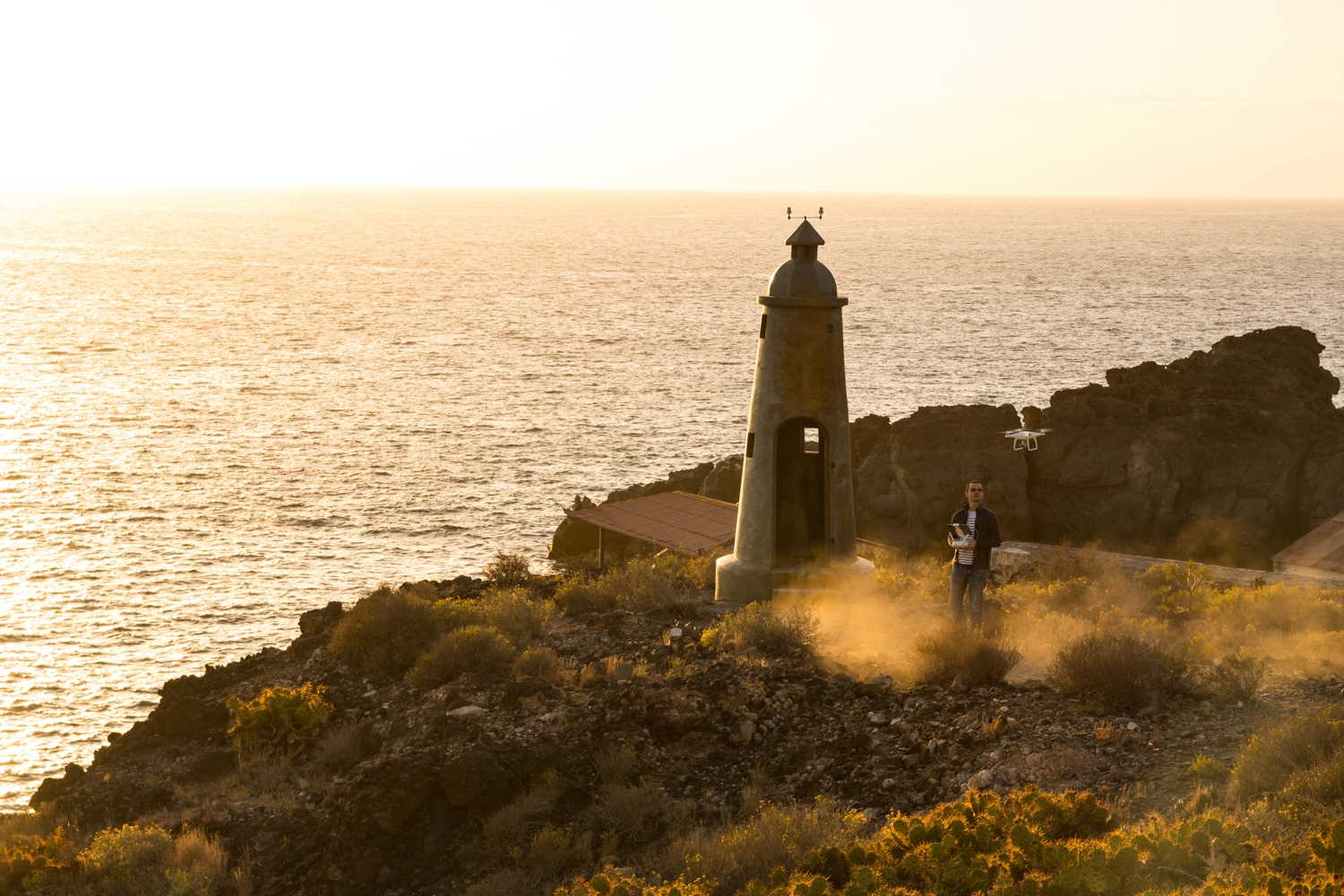 Drone Holiday - Flying a drone next to Lighthouse at sunset on holiday in Tenerife, Spain